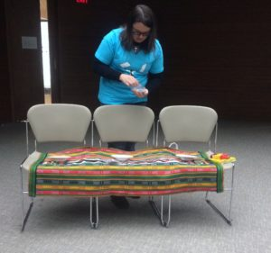 SCMer preparing a table at York University